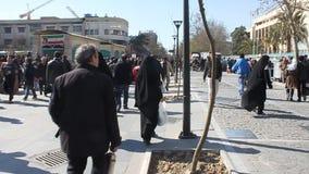 People walk on a pedestrian zone. TEHRAN - FEBRUARY 21: Unidentified people walk on a pedestrian zone on February 21, 2013 in Tehran, Iran stock video