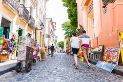 People walk in Pelourinho area, famous Historic Centre of Salvador, Bahia in Brazil Stock Image