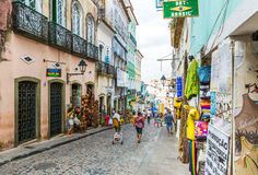 People walk in Pelourinho area, famous Historic Centre of Salvador, Bahia in Brazil Royalty Free Stock Photo