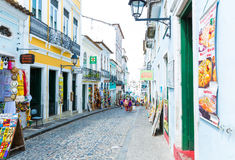 People walk in Pelourinho area, famous Historic Centre of Salvador, Bahia in Brazil Stock Photo