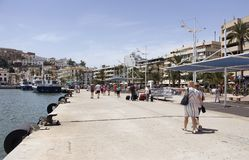 People walk at pier of Ibiza. It is one of the Balearic islands, an archipelago of Spain in the Mediterranean Sea stock photos