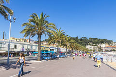 People walk on Promenade des Anglais in Nice, France Royalty Free Stock Photo