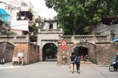 People walk through Quan Chuong Gate, Hanoi Royalty Free Stock Photos