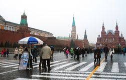 People walk on the Red Square in Moscow. GUM building. Royalty Free Stock Images