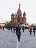 People walk on Red Square. Moscow - January 16, 2015: People walk on Red Square in Moscow near St. Basil's Cathedral January 16, 2015, Moscow, Russia Royalty Free Stock Photography