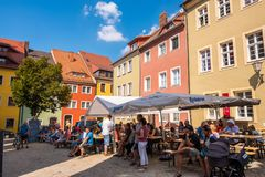 People walk and relax in Animated restaurants, pubs and cafes outdoor at the Old Town Festival in Bautzen