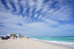 People walk and relax at the sunny South Beach of Miami. Miami Beach, United States - February 11, 2016: People walk and relax at the sunny South Beach of Miami Stock Photos