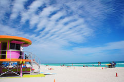 People walk and relax at the sunny South Beach of Miami Stock Image