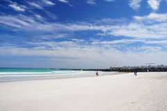 People walk and relax at the sunny South Beach of Miami. Miami Beach, United States - February 11, 2016: People walk and relax at the sunny South Beach of Miami Royalty Free Stock Photography