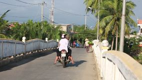 People walk and ride on rural road stock video