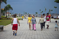 People walk at riverbank Stock Photography