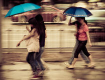 People walk on road in rainy day Stock Photos