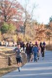 People Walk And Run In Urban Greenspace Along Atlanta Beltline. Atlanta, GA USA - December 5, 2015:  People walk and run along the Atlanta Beltline recreational Stock Image