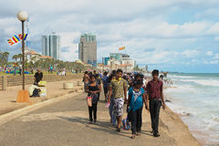 People walk by the seaside in Colombo, Sri Lanka. Royalty Free Stock Photography
