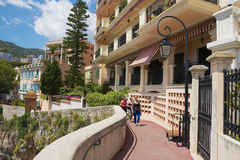 People walk by the seaside passage in the historical part of Monaco. Stock Images