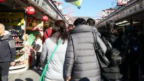 People walk on Senso-ji main street stock video footage
