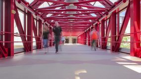 People Walk and Shadows Change in the Red Symmetrical Skyway 4K UHD Timelapse