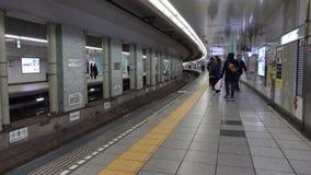 People walk at Shinjuku station in Tokyo, Japan. People walk at the flatform of Shinjuku station in Tokyo, Japan stock footage