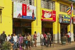 People walk by the shopping street in Nuwara Eliya, Sri Lanka. Stock Photos