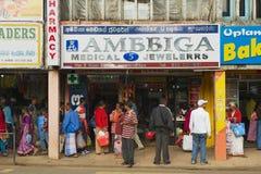 People walk by the shopping  street in Nuwara Eliya, Sri Lanka. Royalty Free Stock Image