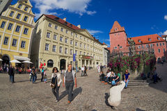 People walk by the street of the historical part of Regensburg, Germany. Royalty Free Stock Photo