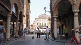 People walk in a street in Mantua city Center.  stock video footage