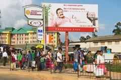 People walk by the street in Nuwara Eliya, Sri Lanka. Stock Photography