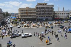 People walk by the street of Sanaa city in Sanaa, Yemen. stock image