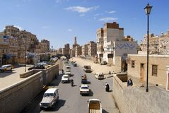 People walk by the street of Sanaa city in Sanaa, Yemen Stock Images