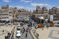 People walk by the street of Sanaa city in Sanaa, Yemen Royalty Free Stock Image