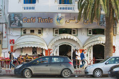 People walk by the street in Sfax, Tunisia. Stock Photos