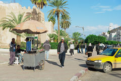 People walk by the street in Sfax, Tunisia. Royalty Free Stock Photos