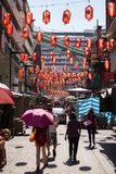 People walk on streets of Chinatown in Singapore. Royalty Free Stock Photo