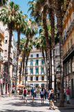 People walk through the streets of Malaga in Spain Royalty Free Stock Photography