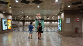 People walk at the subway station in Singapore Stock Photos