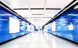People walk in subway tunnels Stock Images