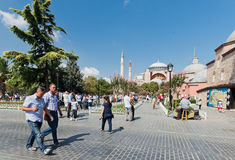 People walk daily in Sultan Ahmet Square in downtown of Istanbul. ISTANBUL, TURKEY - AUGUST 24 : people walk daily in Sultan Ahmet Square in downtown of Istanbul Stock Images