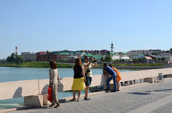 People walk on a summer day at the lake Lower Kaban, Kazan Stock Images
