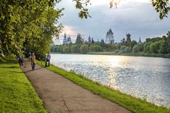 People walk in the summer warm evening in the park. Moscow, Russia - July 22, 2018: People walk in the summer warm evening in the park in the estate Izmailovo royalty free stock image