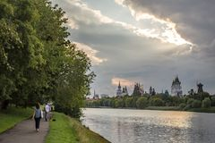 People walk in the summer warm evening in the park. Moscow, Russia - July 22, 2018: People walk in the summer warm evening in the park in the estate Izmailovo stock image