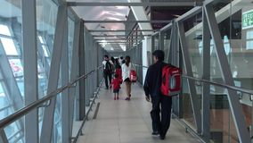 People walk in Tan Son Nhat airport, Vietnam. People walk in Tan Son Nhat airport in Saigon, Vietnam. Tan Son Nhat in Ho Chi Minh City has been ranked 8th in the stock footage