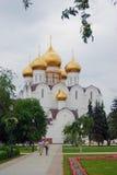 People walk towards Dormition church in Yaroslavl city, Russia Stock Images