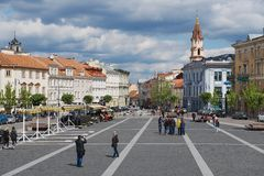 People walk by the Town Hall square in Vilnius, Lithuania. Stock Photography