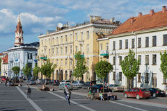 People walk by the Town Hall square in Vilnius, Lithuania. Stock Photos