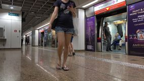 People walk at the train station in Singapore. MRT is a rapid transit system forming the major component of the railway system in Singapore, spanning the stock video footage