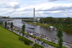 People walk on Tura River Embankment in Tyumen. July 30, 2016. Stock Photos
