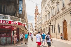 People walk in a typical street of the historic district of Vale. VALENCIA, SPAIN - June 16, 2017 : people walk in a typical street of the historic district of Stock Images