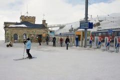 People walk at the upper Gornergratbahn railway station in Zermatt, Switzerland. Stock Photography