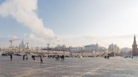 People walk on Vasilyevsky Spusk, Moscow Stock Image