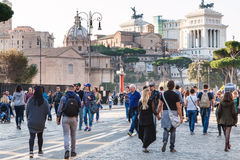People walk on Via dei Fori Imperiali in Rome. ROME, ITALY - OCTOBER 31, 2016: people walk on Via dei Fori Imperiali. It is road in the centre of Rome city that Royalty Free Stock Photos